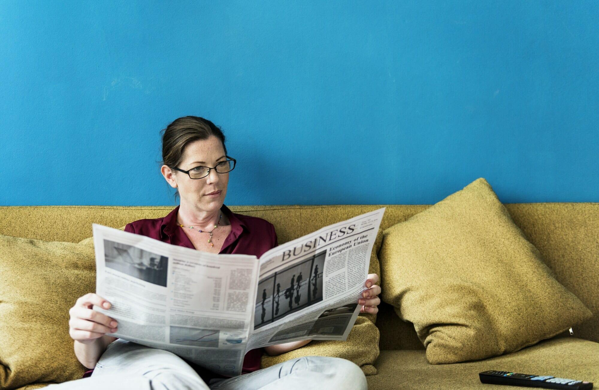 Caucasian woman reading the newspaper